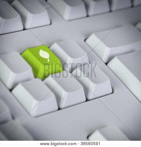 Computer keyboard with green Enter key with recycling symbol business concept