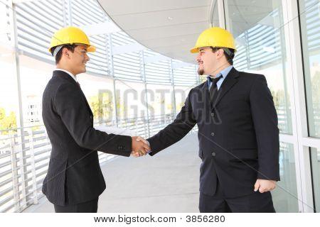 Men Architects Shaking Hands