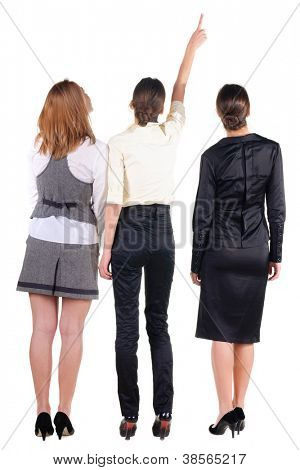 Back view of three beautiful young bussineswoman looking. Rear view people collection.  backside view of person.  Isolated over white background.