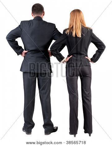 Back view of  business team look into the distance. young couple (man and woman). girl and guy in suit together. Rear view people collection. backside view of person. Isolated over white background