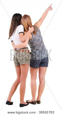 Back view of two young women pointing. Rear view people collection.  backside view of person.  Isolated over white background.