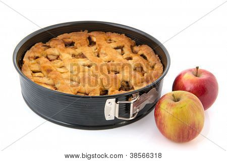 Baked apple pie with fresh red apples isolated over white background