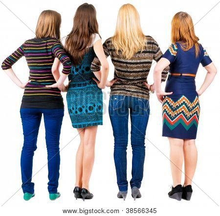 back view of group of young women discussing and watching . girlfriends together. Rear view people collection.  backside view of person.