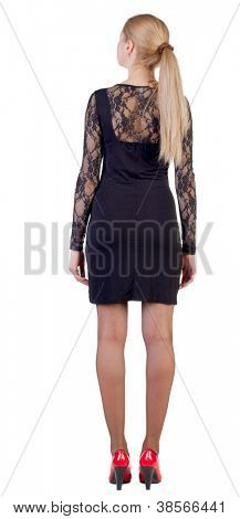 back view of standing beautiful blonde business woman . Young girl in black dress and red kitten heels.  Rear view people collection.  backside view of person.  Isolated over white background.