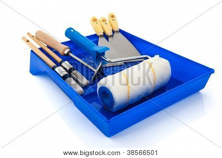 Painters equipment with brushes, paint roller and putty knifes