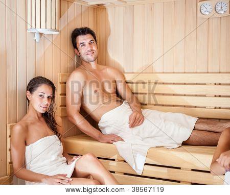 Happy couple having a steam bath in a sauna