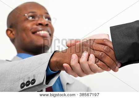 African businessman shaking hands with a caucasian one