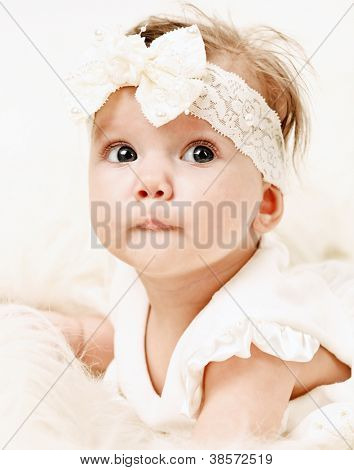 Adorable Portrait of Little Baby Girl in Pink dress dreaming