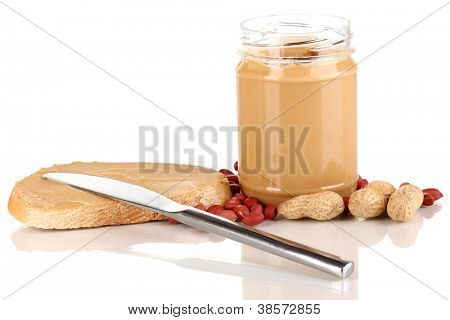 Delicious peanut butter in jar with sandwich isolated on white