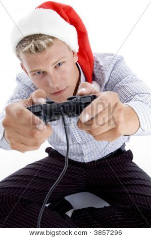 Caucasian Man With Remote And Christmas Hat