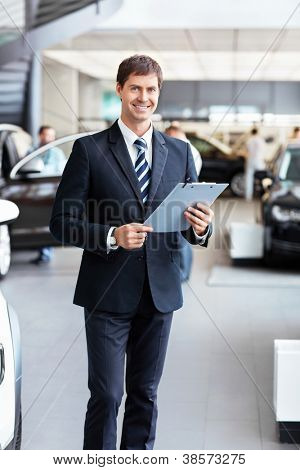 Salesman in the showroom