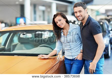 Attractive couple chooses a car