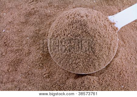 Closeup photo of fine Protein Powder with Chocolate Flavor