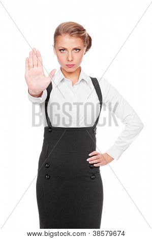 serious businesswoman showing stop gesture. studio shot over white background