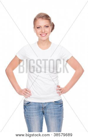 alluring young woman in the white t-shirt and blue jeans standing over white background