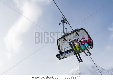 Skiing, winter - skiers on ski lift