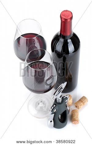 Red wine, corks and corkscrew. Isolated on white background, view from above, focus on glasses.