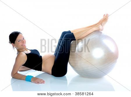 Beautiful pregnant woman at fitness gym with on aerobics ball