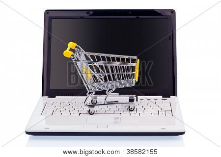 a cart and a computer keyboard. symbol photo online shopping