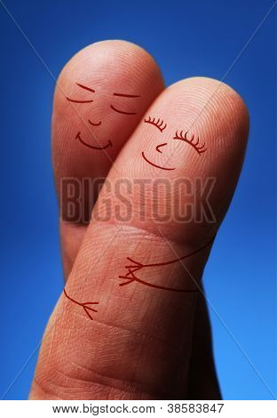 Lucky in love concept, finger people hugging on crossed fingers
