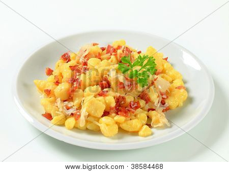 Small potato dumplings with bacon and white cabbage