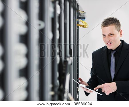 IT engineer business man in network server room using tablet computer