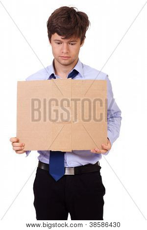 Depressed jobless and homeless young businessman holding a cardboard, isolated on white background