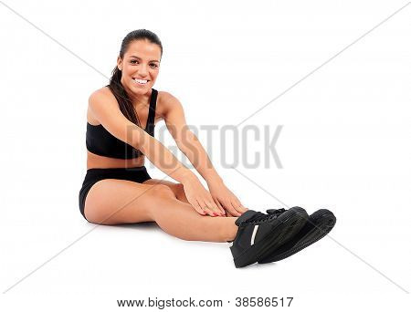Isolated young fitness woman warmup