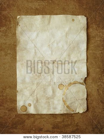 Vintage background with old paper and coffee stain