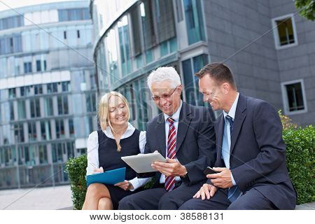 Modern business team working outside the office with tablet PC
