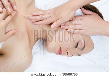 Facial massage to the woman close up