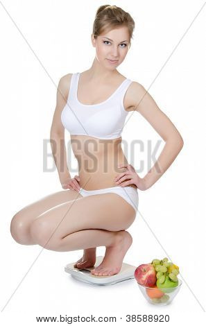 The girl with fruit and vegetables isolated