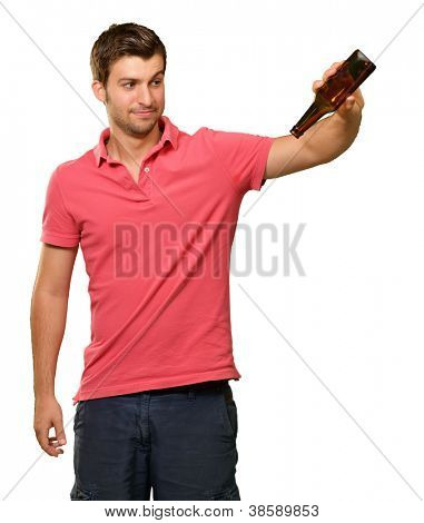Portrait Of Young Man Holding Empty Bottle On White Background