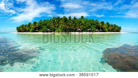 Beautiful Maldivian atoll with white beach seen from the sea.Panorama