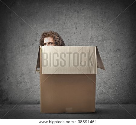 Man hiding in a box