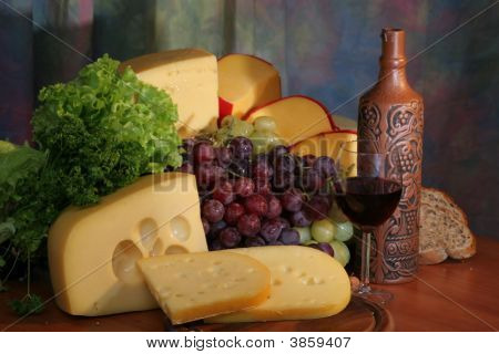 Cheese, Grape, Wineglass And Bottle Of Wine.