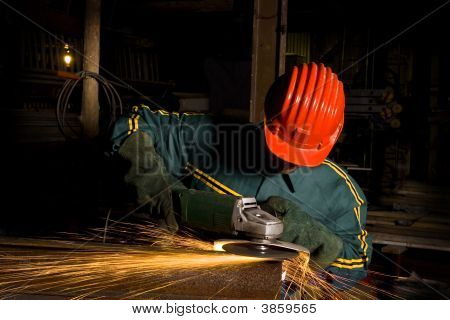 Heavy Industry Worker With Grinder