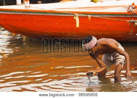 Poor Indian Trawling Ganges River Loose Change
