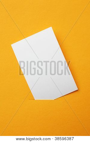 white paper card on orange background