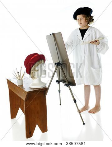 An elementary-aged artist, barefoot while wearing a French beret and white smock, painting a woman's head, a model of which is on a bench before her.  On a white background.