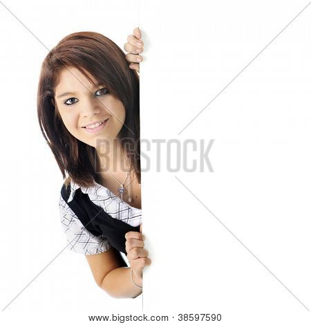 A pretty young teen peeking out from behind a white wall, on a white background.