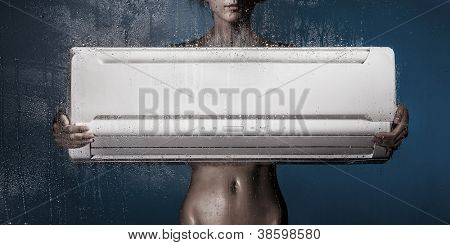 girl holds conditioner standing behind the glass