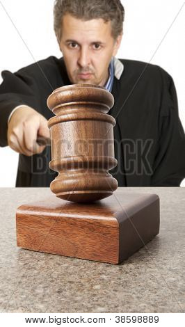 Gavel and male judge isolated on white background