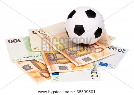 Small soccer ball on heap of euro isolated on a white background