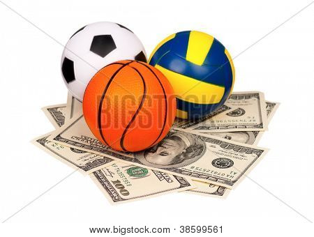 Small balls on heap of dollars isolated on a white background