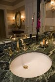 stock photo of bathroom sink  - Bathroom with a designer sink and faucet - JPG