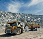 picture of iron ore  - Loading of iron ore on very big dump - JPG