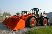 stock photo of dozer  - New shiny and modern orange dozer machines - JPG