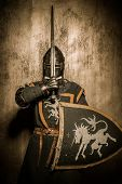 picture of crusader  - Medieval knight  holding sword in front of his face - JPG