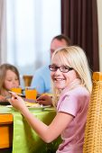image of table manners  - Family eating lunch or dinner and sitting at the table - JPG